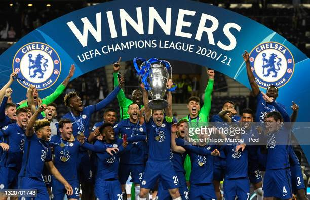 Cesar Azpilicueta of Chelsea lifts the Champions League Trophy following their team's victory in the UEFA Champions League Final between Manchester...