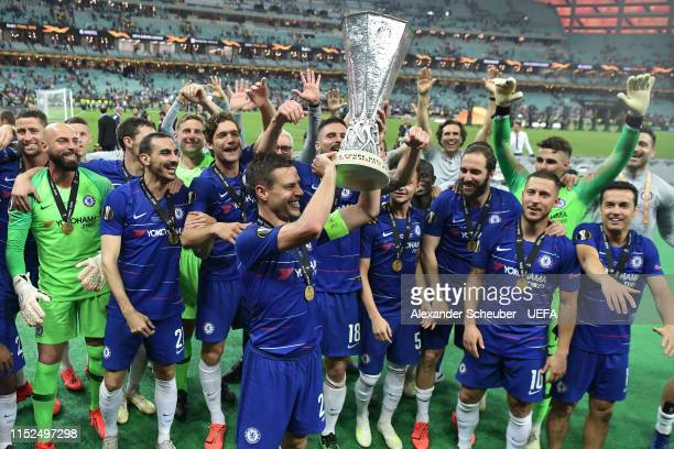 Cesar Azpilicueta of Chelsea lifts the Europa League Trophy with his team following victory in the UEFA Europa League Final between Chelsea and...