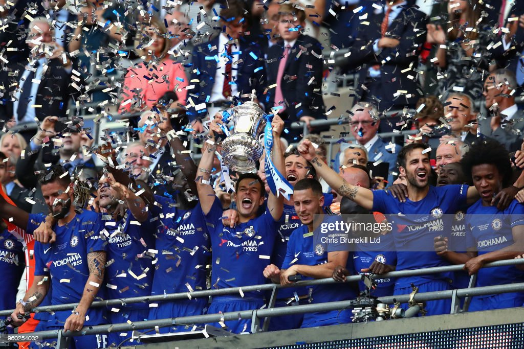 Cesar Azpilicueta of Chelsea lifts the FA Cup trophy after his side won during the Emirates FA Cup Final between Chelsea and Manchester United at Wembley Stadium on May 19, 2018 in London, England.