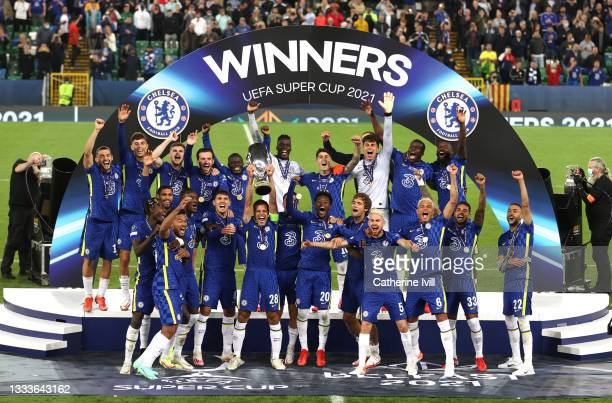 Cesar Azpilicueta of Chelsea lifts the UEFA Super Cup Trophy following victory in the UEFA Super Cup 2021 match between Chelsea FC and Villarreal CF...