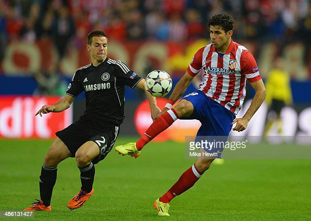 Cesar Azpilicueta of Chelsea marshalls Diego Costa of Club Atletico de Madrid during the UEFA Champions League Semi Final first leg match between...