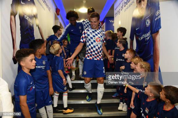 Cesar Azpilicueta of Chelsea meets mascots outside the dressing rooms after the preseason friendly match between Chelsea and Lyon at Stamford Bridge...