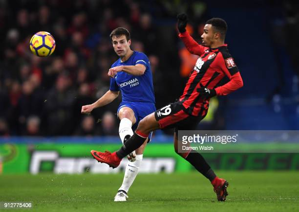 Cesar Azpilicueta of Chelsea passes the ball under pressure from Junior Stanislas of AFC Bournemouth during the Premier League match between Chelsea...