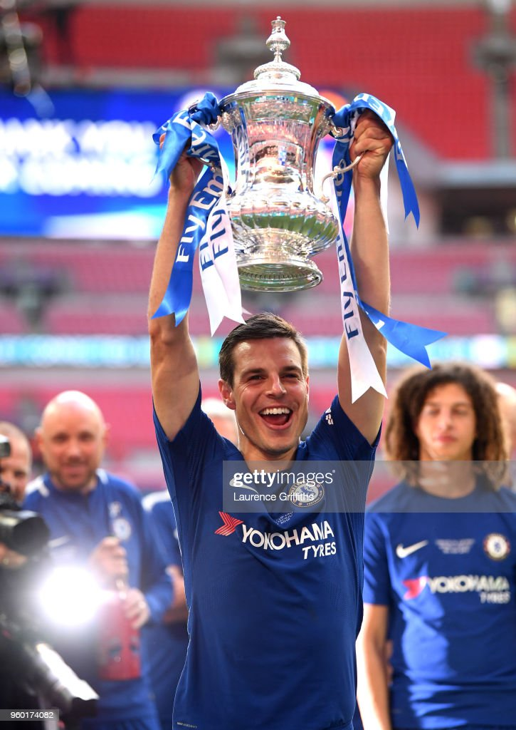 Cesar Azpilicueta of Chelsea poses with the Emirates FA Cup Trophy following his sides victory in The Emirates FA Cup Final between Chelsea and Manchester United at Wembley Stadium on May 19, 2018 in London, England.