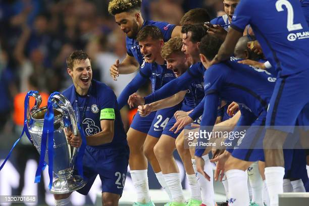 Cesar Azpilicueta of Chelsea prepares to lift the Champions League Trophy following their team's victory during the UEFA Champions League Final...
