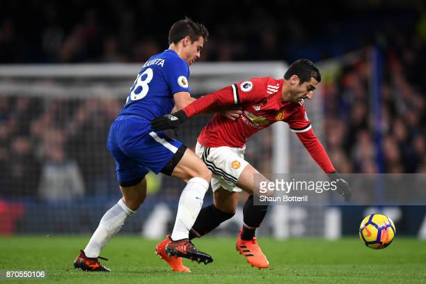 Cesar Azpilicueta of Chelsea puts pressure on Henrikh Mkhitaryan of Manchester United battle for possession during the Premier League match between...