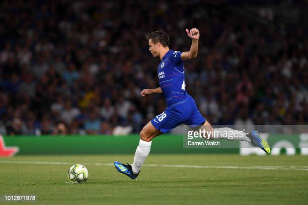 Cesar Azpilicueta of Chelsea scores a penalty during a penalty shootout during the preseason friendly match between Chelsea and Lyon at Stamford...