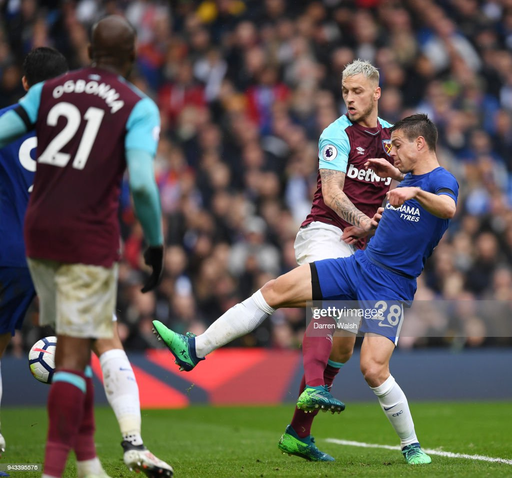 Cesar Azpilicueta of Chelsea scores his sides first goal during the Premier League match between Chelsea and West Ham United at Stamford Bridge on April 8, 2018 in London, England.