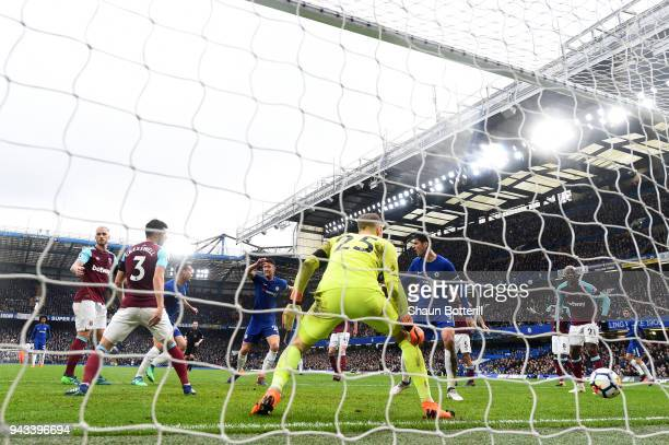 Cesar Azpilicueta of Chelsea scores his sides first goal past Joe Hart of West Ham United during the Premier League match between Chelsea and West...