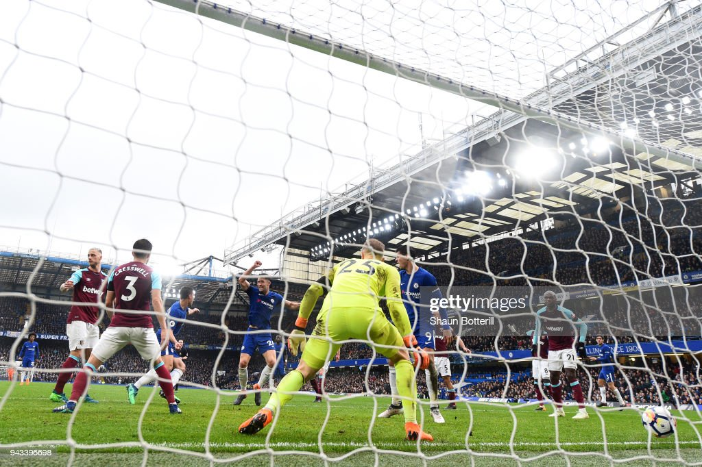 Cesar Azpilicueta of Chelsea scores his sides first goal past Joe Hart of West Ham United during the Premier League match between Chelsea and West Ham United at Stamford Bridge on April 8, 2018 in London, England.