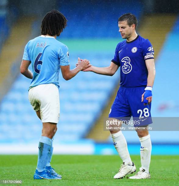 Cesar Azpilicueta of Chelsea shakes hands with Nathan Ake of Manchester City during the Premier League match between Manchester City and Chelsea at...