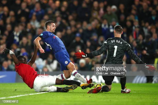 Cesar Azpilicueta of Chelsea shoots past David De Gea of Manchester United during the Premier League match between Chelsea FC and Manchester United...