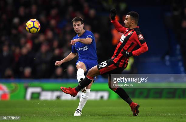 Cesar Azpilicueta of Chelsea shoots under pressure from Junior Stanislas of AFC Bournemouth during the Premier League match between Chelsea and AFC...