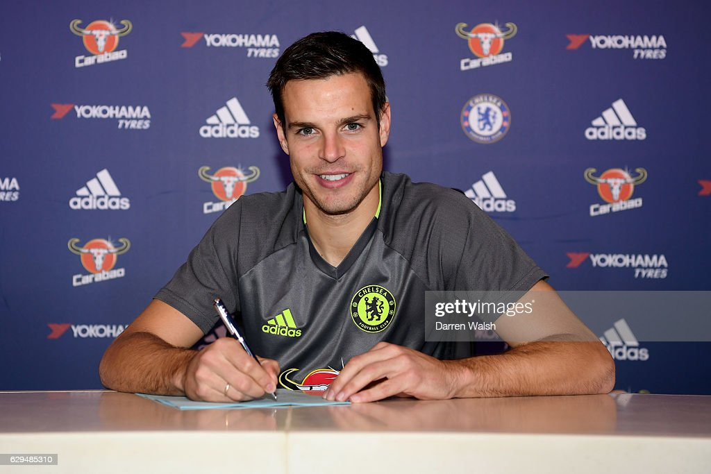 Cesar Azpilicueta of Chelsea signs a new contract at Chelsea Training Ground on December 13, 2016 in Cobham, England.