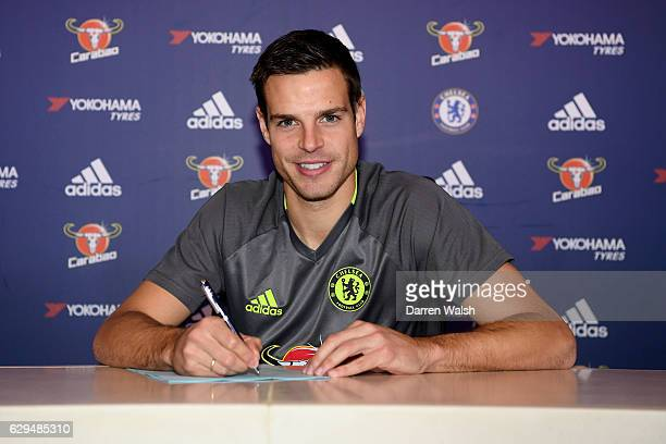 Cesar Azpilicueta of Chelsea signs a new contract at Chelsea Training Ground on December 13 2016 in Cobham England