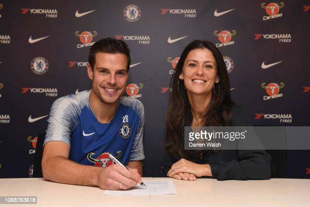 Cesar Azpilicueta of Chelsea signs a new contract with Chelsea FC with Chelsea Director Marina Granovskaia at Chelsea Training Ground on December 3...
