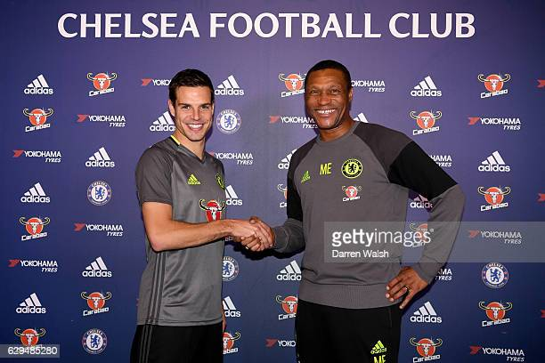 Cesar Azpilicueta of Chelsea signs a new contract with Michael Emenalo at Chelsea Training Ground on December 13 2016 in Cobham England