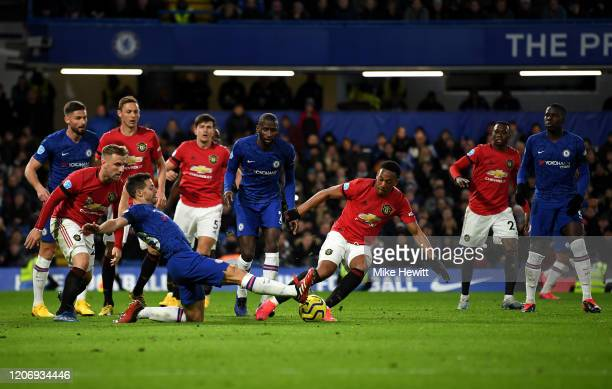Cesar Azpilicueta of Chelsea tackles Anthony Martial of Manchester United during the Premier League match between Chelsea FC and Manchester United at...