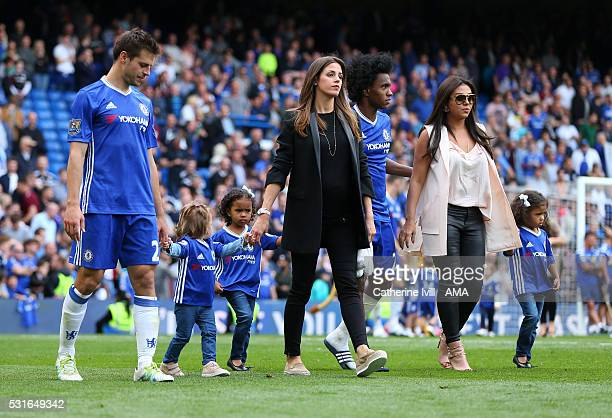 Cesar Azpilicueta of Chelsea with daughter Martina and wife Adriana walk alongside Willian of Chelsea with wife Vanessa Martins and daughters...