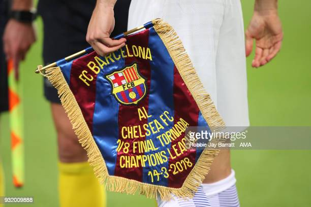 Cesar Azpilicueta of Chelsea with the pennant given to Barcelona during the UEFA Champions League Round of 16 Second Leg match FC Barcelona and...