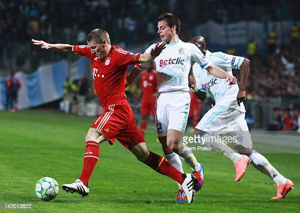 Cesar Azpilicueta of Marseille and Bastian Schweinsteiger of Muenchen battle for the ball during the UEFA Champions League Quarter Final first leg...