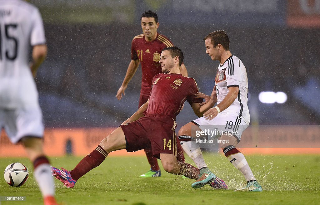 Cesar Azpilicueta (L) of Spain and Mario Goetze (R) of Germany compete for the ball during the International Friendly match between Spain and Germany at Estadio Balaidos on November 18, 2014 in Vigo, Spain.