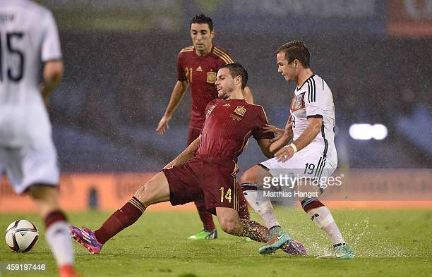 Cesar Azpilicueta of Spain and Mario Goetze of Germany compete for the ball during the International Friendly match between Spain and Germany at...