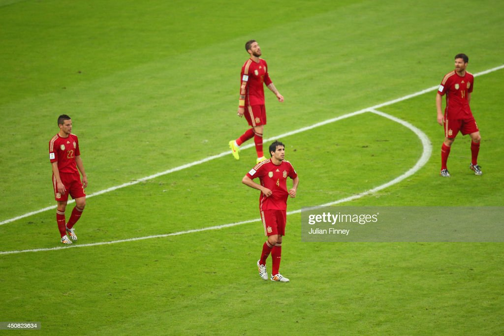 Cesar Azpilicueta, Sergio Ramos, Javi Martinez and Xabi Alonso of Spain react after giving up Chile's first goal during the 2014 FIFA World Cup Brazil Group B match between Spain and Chile at Maracana on June 18, 2014 in Rio de Janeiro, Brazil.