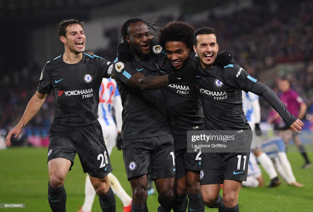 Cesar Azpilicueta, Victor Moses, Willian, and Pedro (goal scorer) of Chelsea celebrate the third during the Premier League match between Huddersfield Town and Chelsea at John Smith's Stadium on December 12, 2017 in Huddersfield, England.