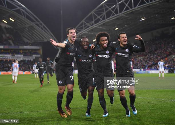 Cesar Azpilicueta Victor Moses Willian and Pedro of Chelsea celebrate the third during the Premier League match between Huddersfield Town and Chelsea...