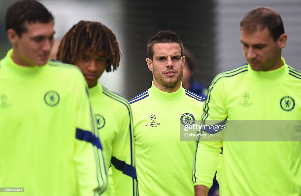 Cesar Azpilicueta walks out onto the pitch during the Chelsea Training Session at Chelsea Training Ground on September 29, 2014 in Cobham, England.