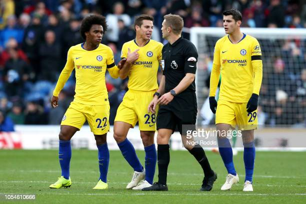 Cesar Azpilicueta Willian and Alvaro Morata of Chelsea speak to referee Craig Pawson during the Premier League match between Burnley FC and Chelsea...
