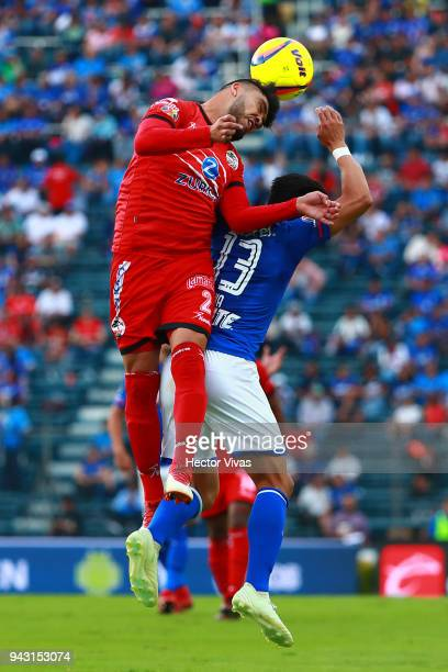 Cesar Cercado of Lobos BUAP goes for a header with Angel Mena of Cruz Azul during the 14th round match between Cruz Azul and Lobos BUAP at Azul...