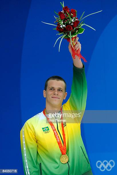 Cesar Cielo Filho of Brazil celebrates with his gold medal after winning the Men's 50m Freestyle Final held at the National Aquatics Centre during...
