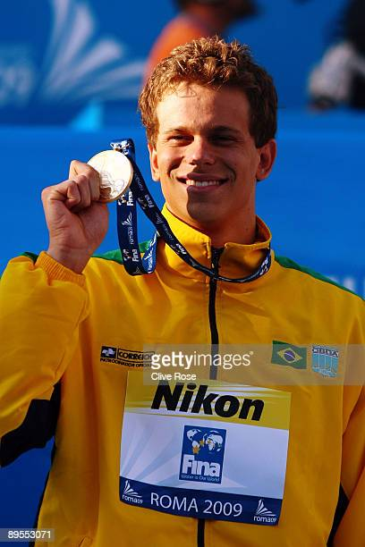 Cesar Cielo Filho of Brazil receives the gold medal during the medal ceremony for the Men's 50m Freestyle Final at the 13th FINA World Championships...