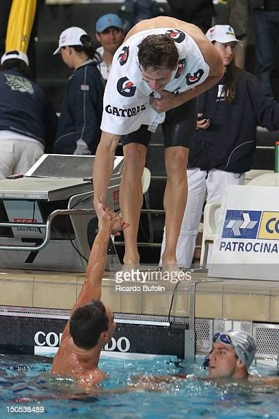 Cesar Cielo, from Brazil, celebrates the victory with your teammate, during the Jose Finkel Trophy of swimming at SESI Vila Leopoldina pool on Aug...