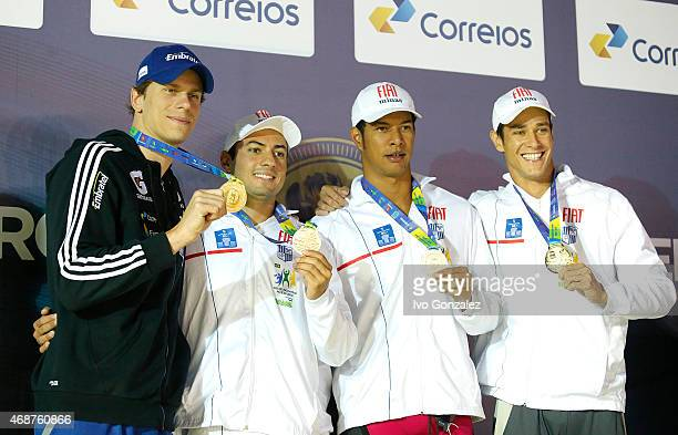 Cesar Cielo Italo Duarte Alan Vitoria and Felipe Souza Martins pose with the golden medal after winning the Men's 4x50m freestyle final on day one of...