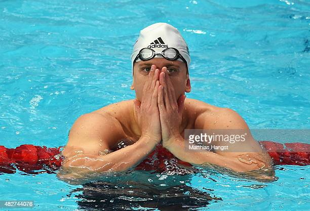 Cesar Cielo of Brazil reacts after competing in the Men's 50m Butterfly Heats on day nine of the 16th FINA World Championships at the Kazan Arena on...