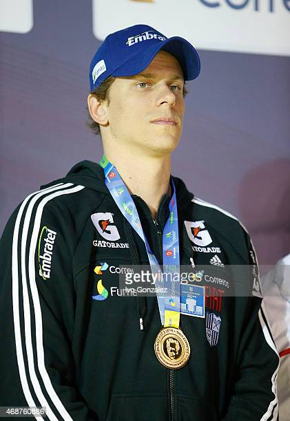 Cesar Cielo poses with the golden medal after swimming the Men's 4x50m freestyle final on day one of the Maria Lenk Swimming Trophy at Fluminense...