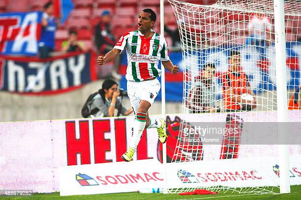 Cesar Cortes of Palestino celebrates after scoring the fourth goal of his team during a match between U de Chile and Palestino as part of fifth round...
