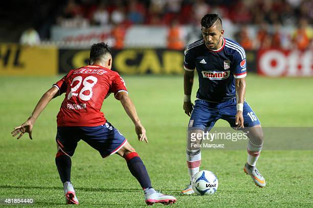 Cesar de la Pe–na of Chivas drives the ball against Arturo Paganoni of Veracruz during a 1st round match between Veracruz and Chivas as part of the...