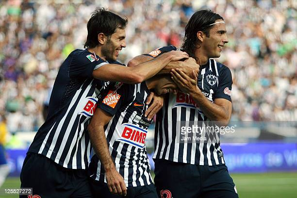 Cesar Delgado of Monterrey celebrates a scored goal with teammates during a match as a part of the Apertura 2011 Tournament in the Mexican Football...