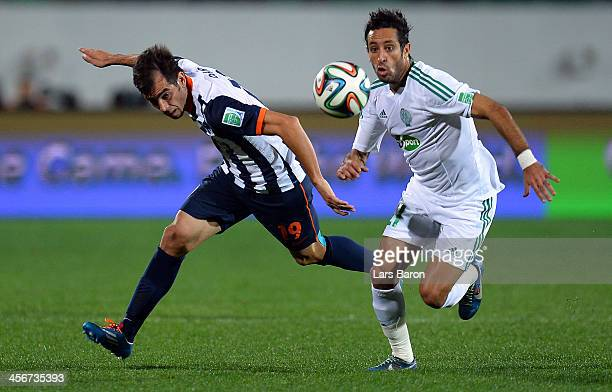 Cesar Delgado of Monterrey is challenged by Adil Karrouchy of Casablanca during the FIFA Club World Cup Quarterfinal match between Raja Casablanca...
