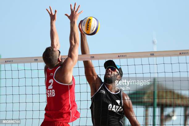 Cesar Do Nascimento Junior Julio of Qatar in action with Ahmed Tijan of Qatar during the match against Lazar Kolaric and Djordje Klasnic of Serbia on...