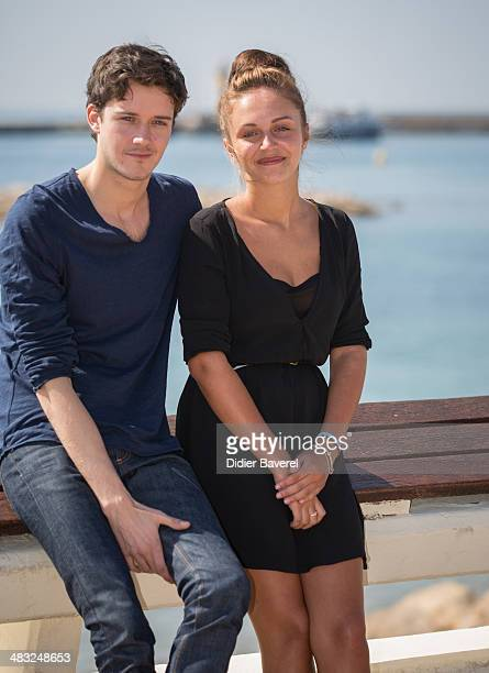 Cesar Domboy and Pauline Burlet poses during the photocall of 'Resistance' at MIPTV 2014 at Hotel Majestic on April 7 2014 in Cannes France