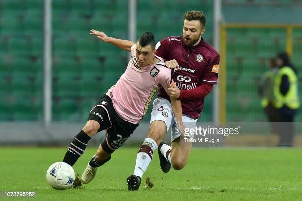 Cesar Falletti of Palermo and Davide Agazzi of Livorno compete for the ball during the Serie B match between US Citta di Palermo and AS Livorno at...