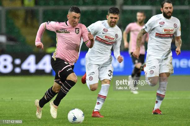 Cesar Falletti of Palermo is challenged by Massimiliano Busellato of Foggia during the Serie B match between US Citta di Palermo and Foggia at Stadio...