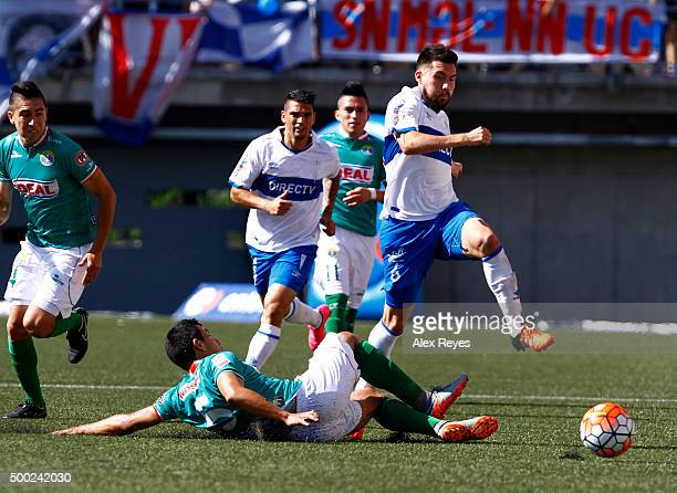 Cesar Fuentes of Universidad Catolica fights for the ball with Sebastian Silva of Audax Italiano during a match between Audax Italiano and...