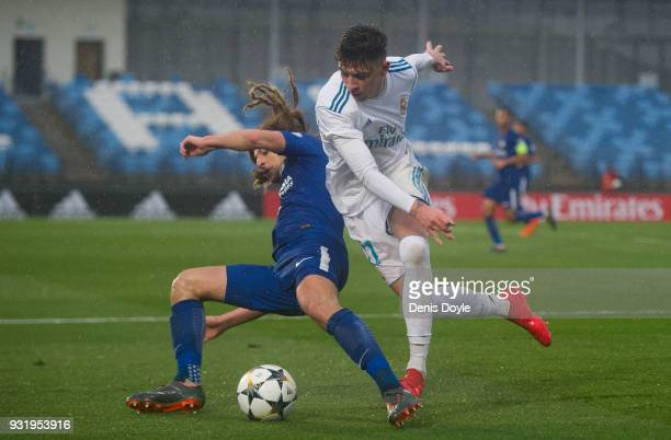 Cesar Gelabert Pina of Real Madrid is tackled by Ethan Ampadu of Chelsea during the UEFA Youth League Quarterfinal between Real Madrid and Chelsea at...