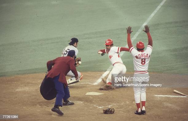 Cesar Geronimo of the Cincinnati Reds scores as Thurman Munson of the New York Yankees can't handle the ball during Game 2 of the 1976 World Series...